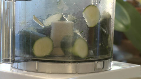 Close up of zucchini being chopped in a food processor Stock Video Footage