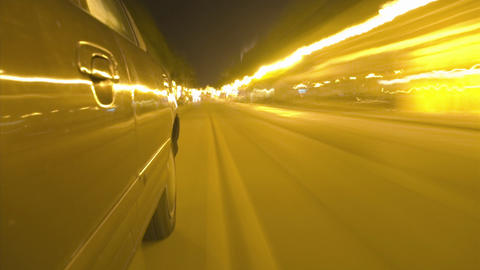 A car travels on a busy city street Footage