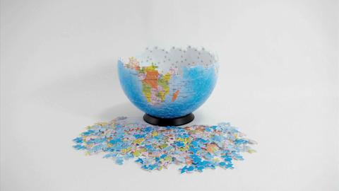 A globe-shaped puzzle disassembles Footage