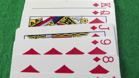 The camera moves across a deck of cards laid out on a... Stock Video Footage