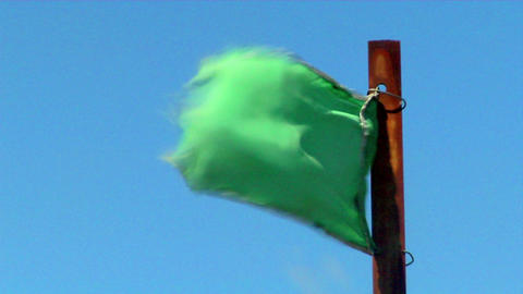 A green flag blows in the wind Stock Video Footage