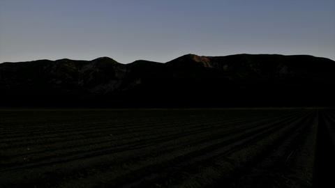 Time lapse of the light diminishing on some mountains and... Stock Video Footage