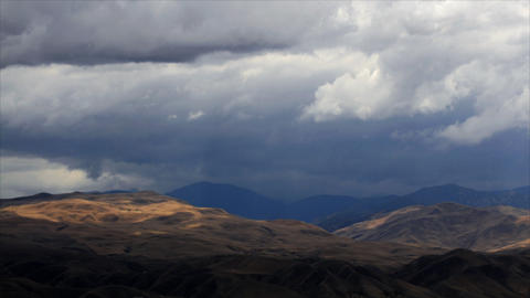 Time-lapse of rainclouds over mountains Stock Video Footage