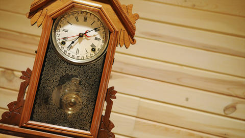 Time lapse of antique pendulum clock running Footage