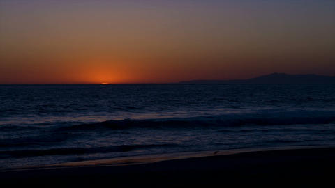 Time lapse of sun setting over the ocean Footage