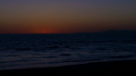 Time lapse of sun setting over the ocean Stock Video Footage