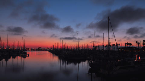 Time lapse of a harbor during sunset Stock Video Footage