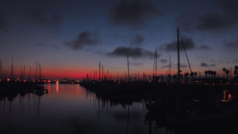 Time lapse of a harbor during sunset Footage