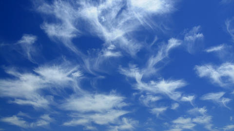 Time lapse of wispy clouds moving across the sky Footage