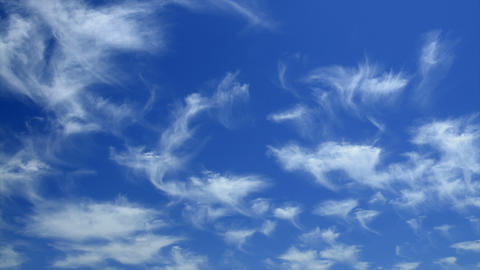 Time lapse of wispy clouds moving across the sky Stock Video Footage