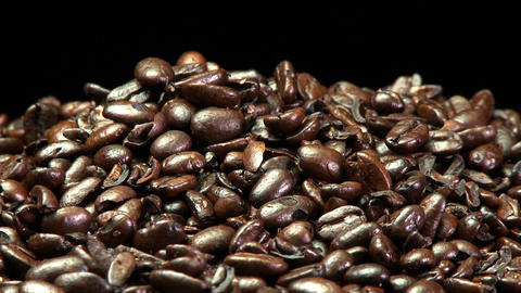 A pile of roasted coffee beans slowly rotating Stock Video Footage