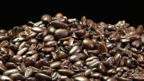 A still shot of a pile of roasted coffee beans Stock Video Footage