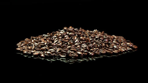 A distant shot of a pile of roasted coffee beans Stock Video Footage