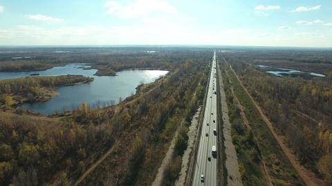 Aerial footage of road and people traveling by cars on a highway Live Action