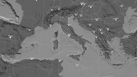 Zoom-in on Italy outlined. Grayscale contrasted Animation