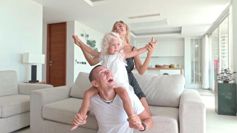 Family having fun in the living room Live Action