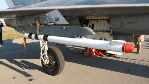 View of Air to Air Russian made missile under a soviet era military jet MiG 21 Live Action
