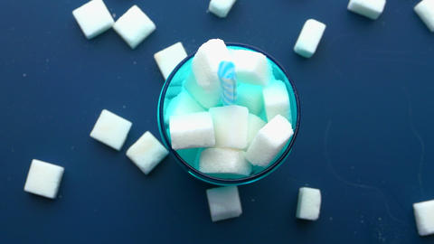Top view of sugar cubes in a jar Live Action