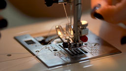 Sewing on a sewing machine. Close up of women's hands seamstresses Live Action
