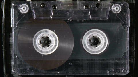 Audio cassette rewind or fastfoward until reaches the end Footage