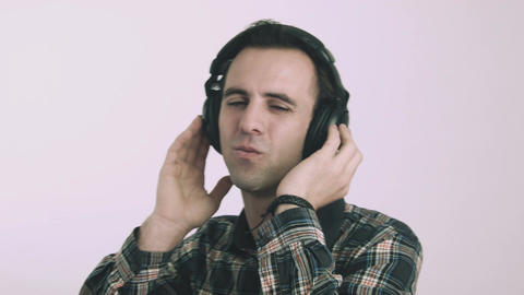 Young man listening to music on headphones Footage