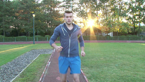 Young man jogging at sunrise Footage