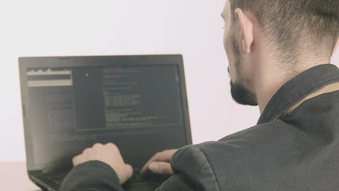 Business man computer programmer typing at his desk Footage