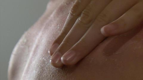 Boy peeling skin Footage