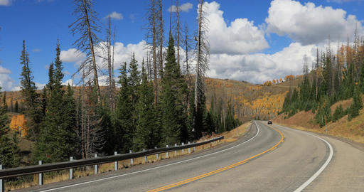 Car high mountain road in autumn fall colors DCI 4K 680 Footage