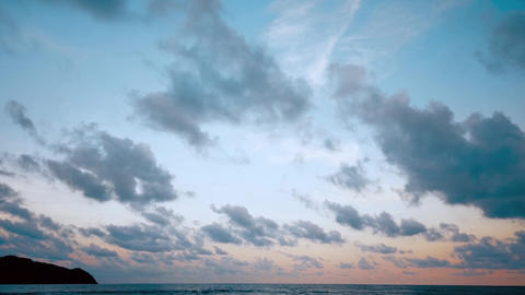 Red sunsets over sea. Blue and pink sky with clouds. Summer sunset seascape. 4k Live Action