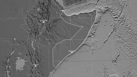 Zoom-in on Somalia outlined. Grayscale contrasted Animation