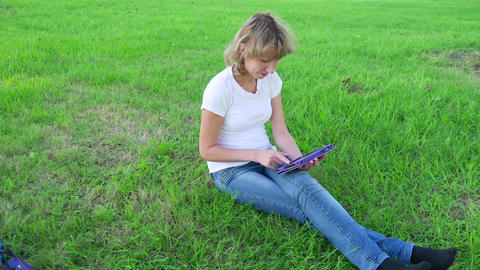 Girl with a tablet computer communicates in a social network Live Action