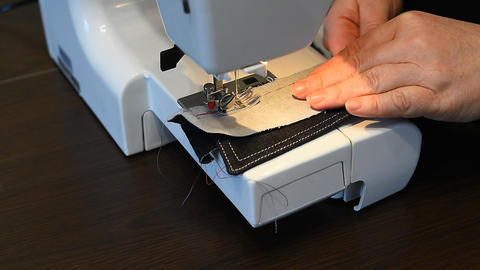 Processing details of clothes on a sewing machine Live Action