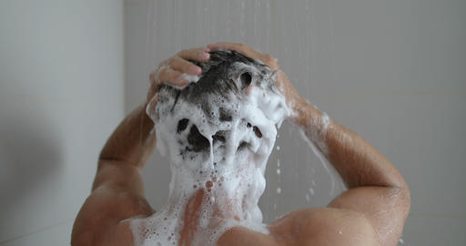Shower man washing hair showering in bathroom at home Live Action