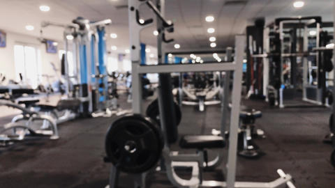 Defocused view of a city gym with equipment for fitness routine and workout Live Action