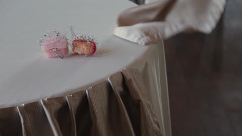 Professional decorator decorates a wedding table Live Action