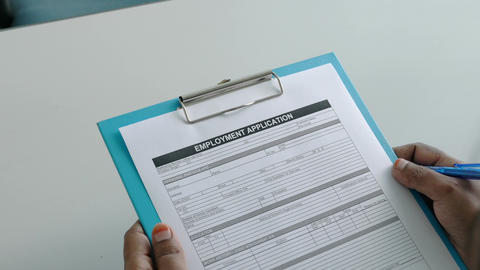 Job seeker or candidate about to fill up an employment application form. Employment or hiring Live Action