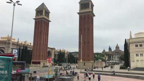 Barcelona, Spain. A large clock tower towering over a city Live Action