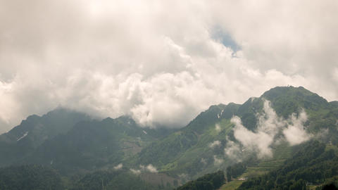 Mountainside in clouds. Zoom. Time Lapse. Rosa Khutor, Sochi, Russia Footage