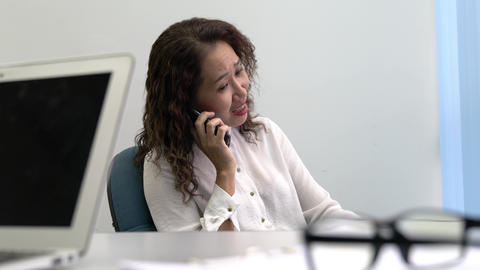 Businesswoman talking on the cellphone with angry expression and gestures Live Action