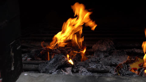 View inside a chinese temple furnace, burning joss papers as part of worship and prayers Live Action