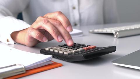 Accountant using calculator, closeup Live Action