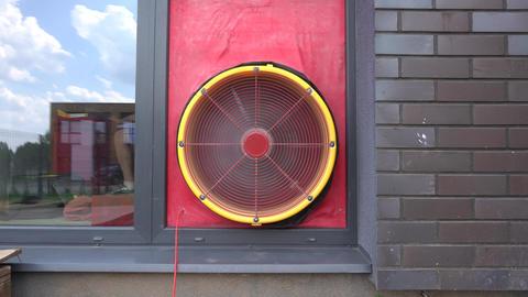 Door blower test equipment mounted on townhouse door. Gimbal movement Live Action