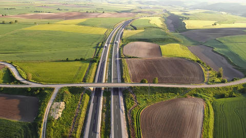 Highway with traffic in rural scenery. Suburban highway with cars and trucks Live Action