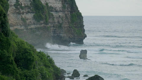 Green cliffs on the Bali shoreline. Indonesia, slow motion Live Action