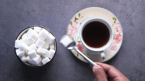 Top view of tea and sugar cube with copy space Live Action
