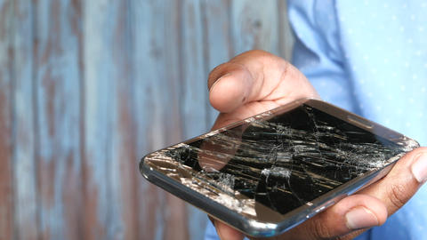 Close up of man hand holding broken smart phone Live Action