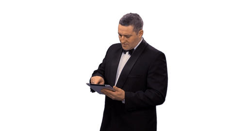 Businessman using tablet computer, alpha channel Footage