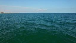 Aerial flight over Black Sea and seagulls floating Footage