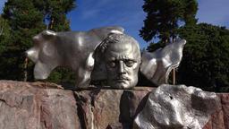 Jean Sibelius Monument in Helsinki. Shining face bas-relief on granite pedestal Footage